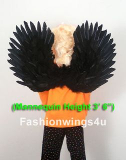 Childrens black swan costume feather wings pointing up/down flying