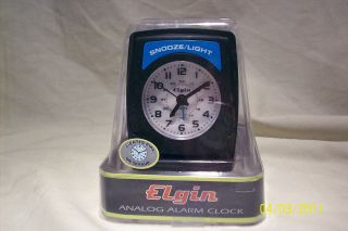 ELGIN ANALOG ALARM CLOCK W/LIGHT UP SNOOZE – GREAT FOR TRAVEL; MODEL