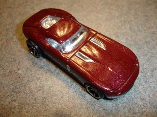 Collectible Metallic Maroon Diecast Hot Wheels Fast Fe Lion Toy Car
