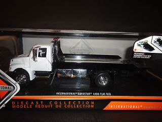 International 4400 Durastar Flat bed Tow Truck Chrome Bed White 1/24