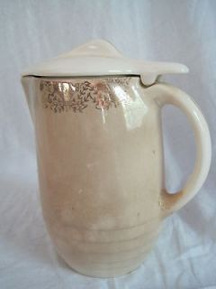 Tip Top Refrigerator Jug From Universal Potteries Cambridge Ohio  Gold