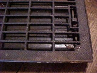 Vintage cast iron heating grate with damper textured design