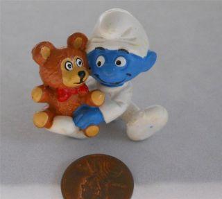 Vintage 1982 Peyo Baby Smurf with teddy bear