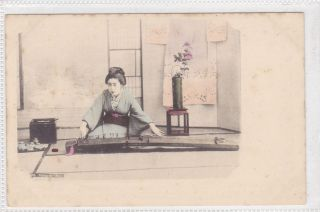 Geisha playing Koto music Japan Japanese early musical instrument