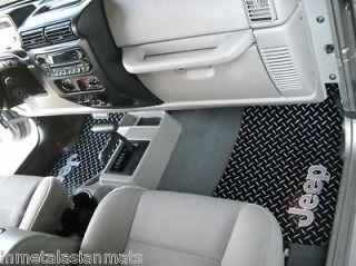 floor mats. Black Metal diamond plate aluminum. Custom fit front rear