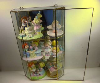 SET OF 7 CABBAGE PATCH KIDS FIGURINE IN GLASS CASE YEAR 1984