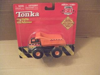 Tonka 60 th anniversary no 768 Orange Mighty Dump Truck 4 inches long