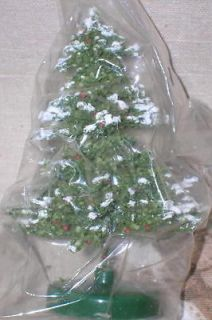 snow flocked christmas tree in Artificial Trees