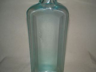 EMBOSSED INDIAN WAR BONNET MEDICINE/CURE BOTTLE INDIAN SAGWA