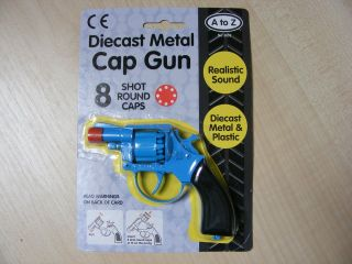 SMALL BLUE METAL TOY CAP GUN TAKES 8 SHOT RED PLASTIC RING CAPS