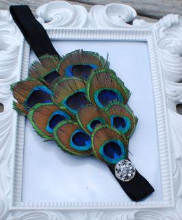peacock feather headband embellished with rhinestone on black elastic