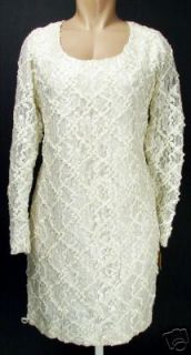This auction is for a genuine Andre Van Pier ivory lace cocktail dress