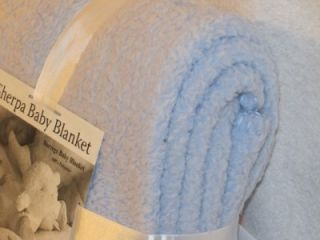 This super soft, light blue sherpa blanket by Borrego feels and looks