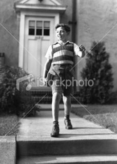 Boy (10 11) on way to school, (B&W) Royalty Free Stock Photo