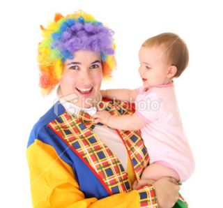 stock photo 9416802 clown holding a baby