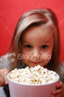 Little girl with popcorn Royalty Free Stock Photo