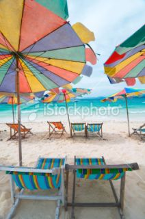 Beautiful beach with outdoor chairs Royalty Free Stock Photo