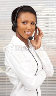 Support phone operator in headset at office. Royalty Free Stock Photo