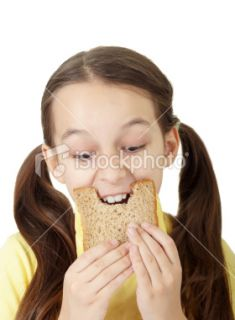 little girl eating sandwich food biting Royalty Free Stock Photo