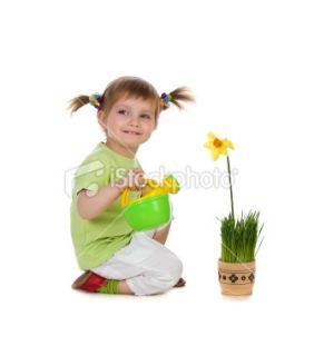 Cute little girl watering the flower Royalty Free Stock Photo