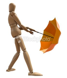Posing wooden manikin with umbrella. Royalty Free Stock Photo