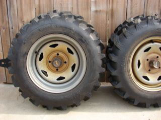 Ag Tires (4) and steel wheels four hole lug fits most Hondas and other