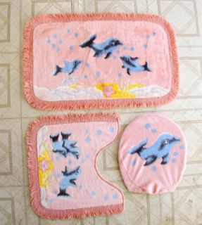Three piece bath mat set. The backing is non slip. These are new. Bath