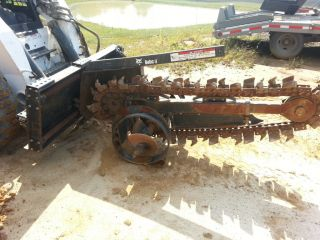 Bobcat tire wheel track skidsteer loader trencher machine attachment
