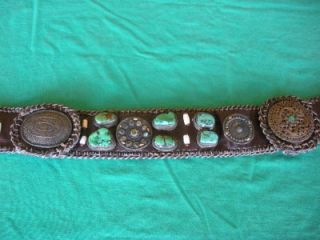 Antique leather and silver belt sewn with Chesnee coat closers and