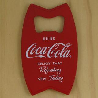 Drink Coca Cola red hand held bottle opener/fridge magnet. Solid metal