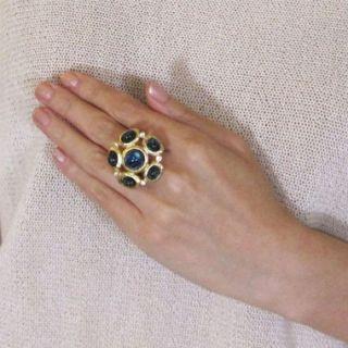 22 karat gold plated, Swarovski crystal, resin stone.