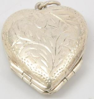 925 Sterling Silver Heart Locket Folds Out to Clover Pattern