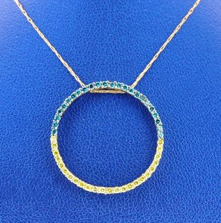 LADIE S DIAMOND CIRCLE NECKLES 10K Y G WITH 0 50 CARAT BLUE YELLOW