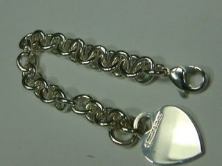 Authentic Tiffany Co. . Lock Charm Bracelet   Sterling Silver MSRP $