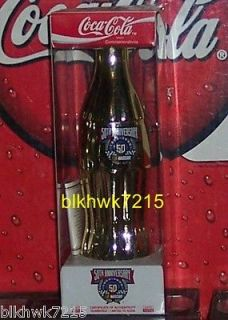 NASCAR 50TH ANNIVERSARY GOLD TONED 8 OUNCE GLASS COCA   COLA BOTTLE