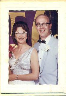 hot burnette in v cut formal w/white cats eye glasses poses w/dork