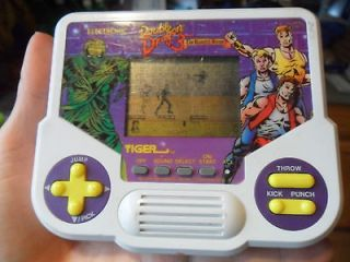 1990 ELECTRONIC DOUBLE DRAGON THE ROSETTA STONE GAME IN GOOD USED