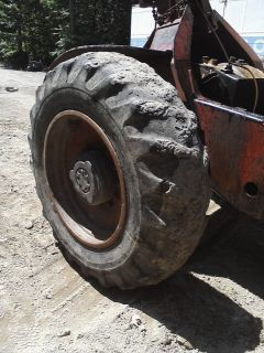 18 4 34 Skidder Tires on 12 Lug Wheels